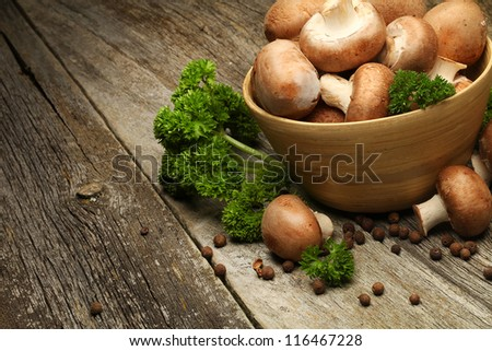 Fresh mushrooms on a wooden board - stock photo