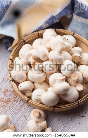 Fresh mushrooms on white table. Selective focus. Rustic style.