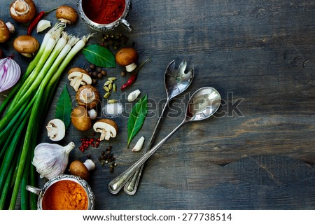 Fresh mushrooms with vegetables and spices on dark wooden table. Background with space for text. Vegetarian food, health or cooking concept. - stock photo
