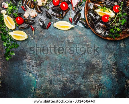 Fresh mussels with ingredients for cooking on rustic background, top view, border. Seafood concept - stock photo