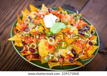 Fresh nachos on the table closeup - stock photo