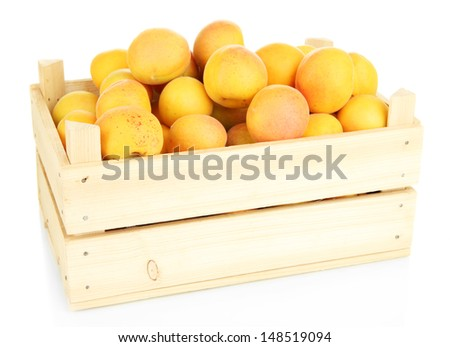 Fresh natural apricot in wooden box isolated on white