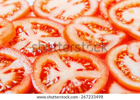 Fresh Natural background with slices of tomato. focus in the middle of the frame, shallow depth of field - stock photo