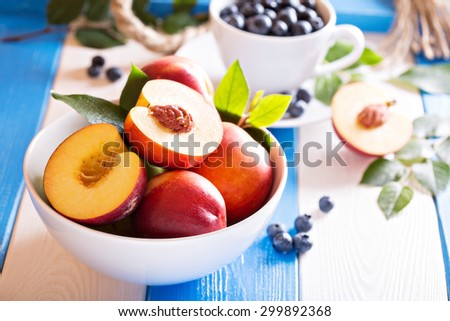 Fresh nectarines in a bowl with colorful background - stock photo