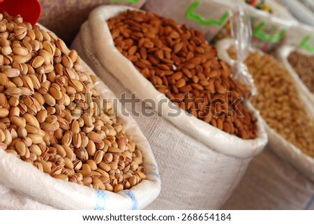 fresh nuts from the weekly market - stock photo