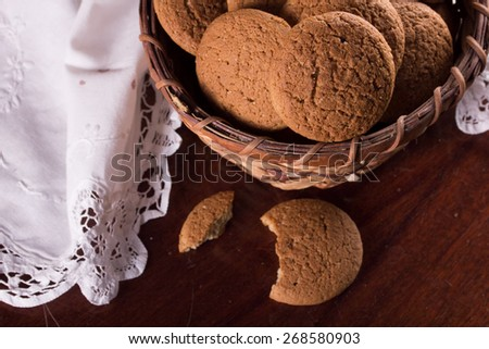 Fresh oatmeal cookies in a basket and a white napkin