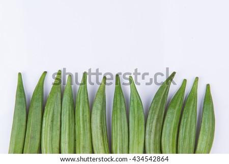 fresh okra on white background - stock photo