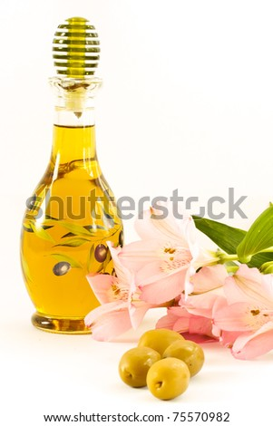 fresh olive oil in a glass bottle on a white background