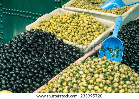 Fresh olives on market in Morocco. - stock photo
