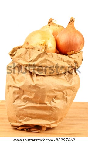 Fresh onion in a brown paperbag