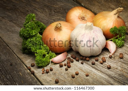 fresh onions and garlic on the wooden board - stock photo