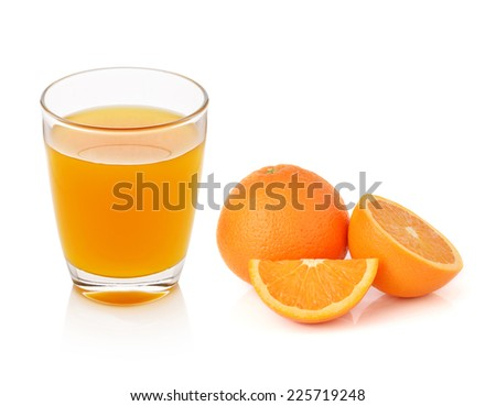 Fresh orange and glass with juice - stock photo