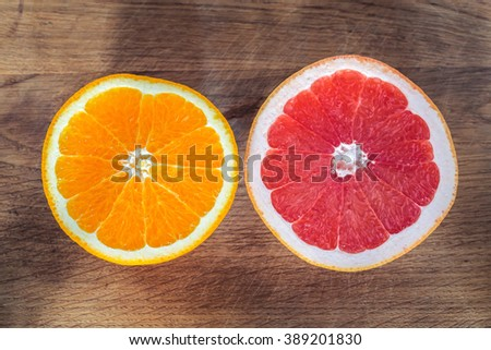 Fresh Orange and Grapefruit on Wooden Background