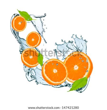 fresh orange and leaf in water splash - stock photo
