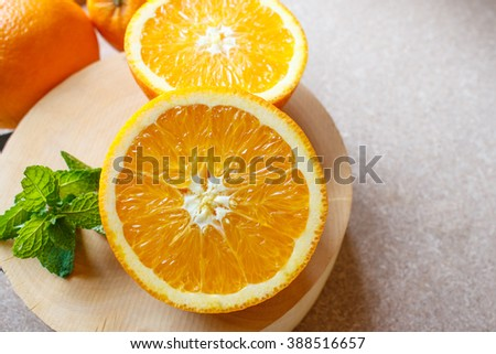 Fresh orange fruit and peppermint on wooden