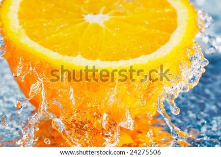 fresh orange in streaming water - stock photo