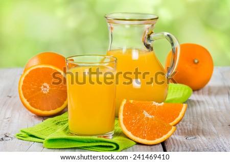 Fresh orange juice on a wooden background - stock photo
