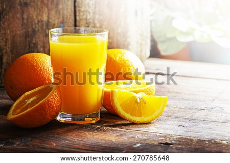 Fresh orange juice on wooden table/ Selective focus