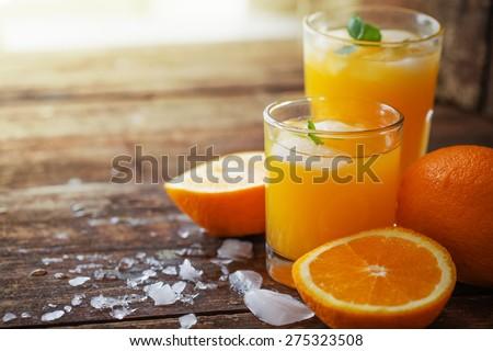 Fresh orange juice on wooden table/ Selective focus - stock photo