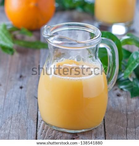 fresh orange juice, square image - stock photo