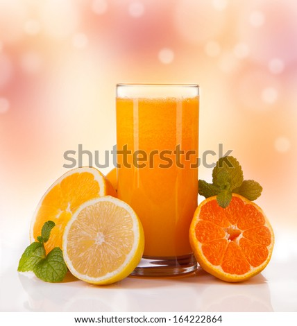 Fresh orange juice with abstract background