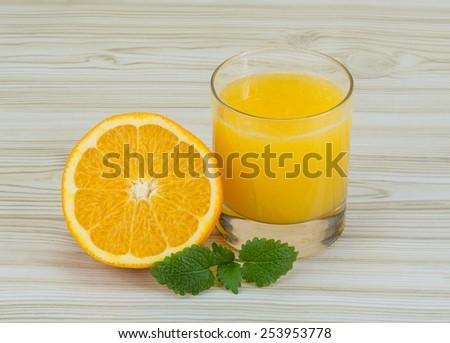 Fresh orange juice with fruit and mint leaves - stock photo
