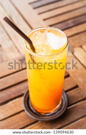Fresh orange juice with heart ice cube - stock photo
