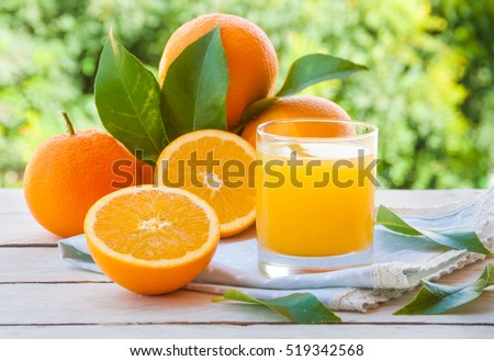 Fresh orange juice with  oranges fruit outdoors