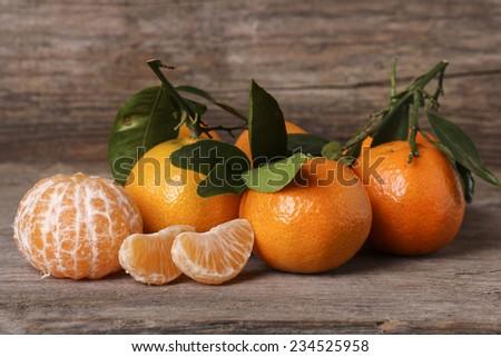 fresh orange mandarins on a wooden background - stock photo