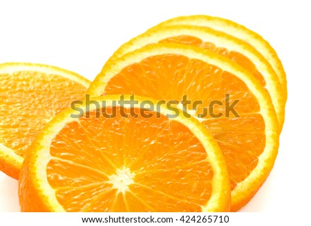 Fresh orange slices on white background. Close-up. Studio photography. - stock photo
