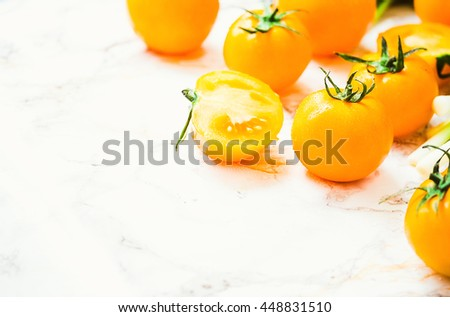 fresh orange tomatoes, juicy summer vegetables and juicy greens, healthy lifestyle and food concept,space for text - stock photo