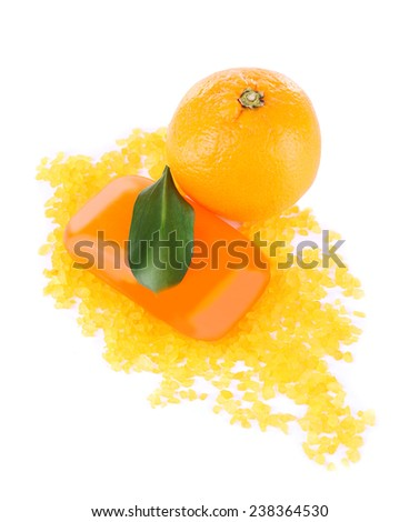 Fresh orange with bath salt and bar of soap isolated on white - stock photo