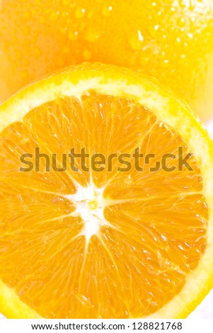 Fresh orange with water drops - stock photo
