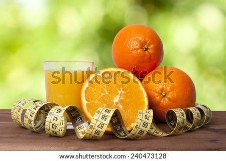 fresh oranges and tape - stock photo