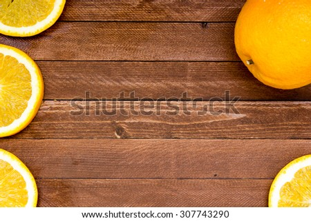 fresh oranges on a wooden background, copy space - stock photo