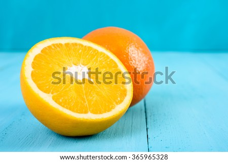 Fresh Oranges On Turquoise Background - stock photo