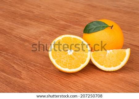 Fresh oranges on wooden background - stock photo