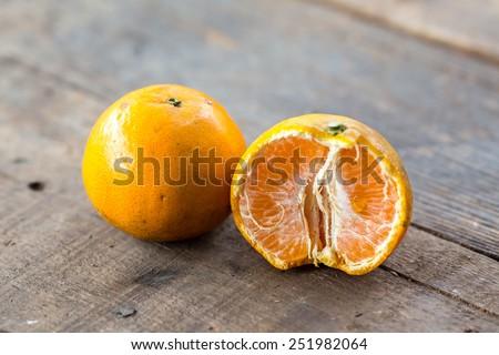 fresh oranges, oranges on a wooden background - stock photo