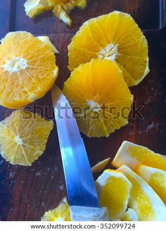 Fresh oranges peeled and cut into rounds - stock photo
