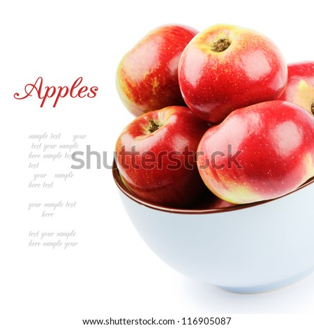 Fresh organic apples in a bowl isolated over white