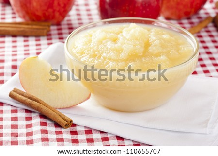 Fresh Organic AppleSauce with cinnamon against a background