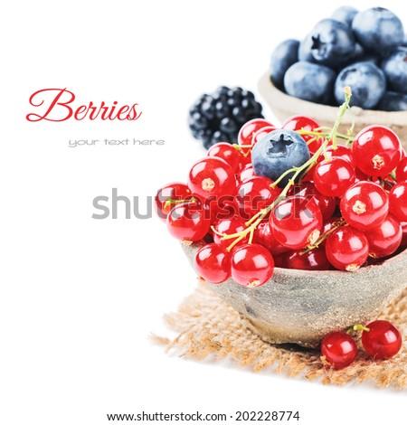 Fresh organic berries isolated over white - stock photo