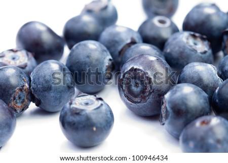 Fresh organic blueberries isolated on white - stock photo