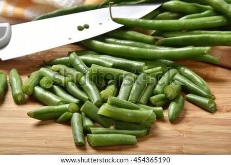Fresh organic cut green beans on a cutting board - stock photo
