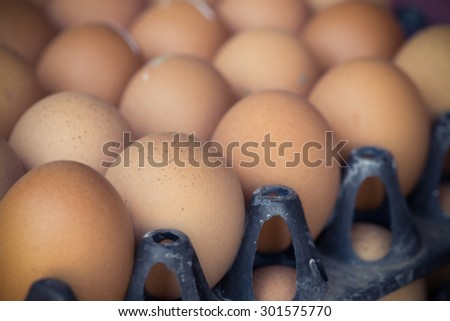 fresh organic eggs from chicken farm agriculture for sale at the market, image used vintage filter - stock photo