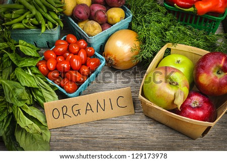 Fresh organic farmers market fruit and vegetable on display - stock photo