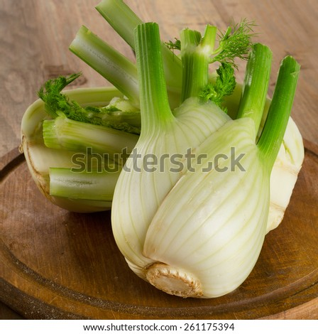 Fresh organic fennel on wooden board. Selective focus