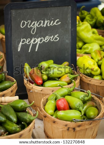 Fresh organic food at the local farmers market. Farmers markets are a traditional way of selling agricultural products. - stock photo
