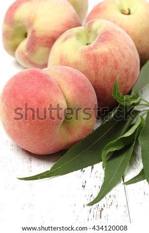 Fresh organic fruit - peaches on wood background selective focus - stock photo
