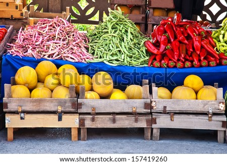 Fresh Organic Fruits and Vegetables At A Street Market Juan Canary Melon, Red and Green Pepper, (Red Mullet) Kidney and Green Beans   - stock photo